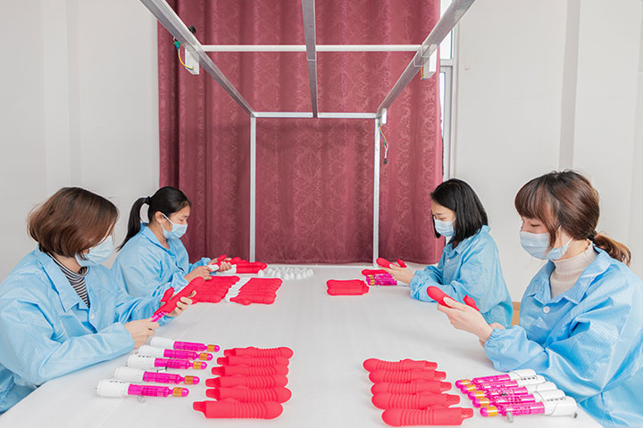 workers are assembling sex toys by hand